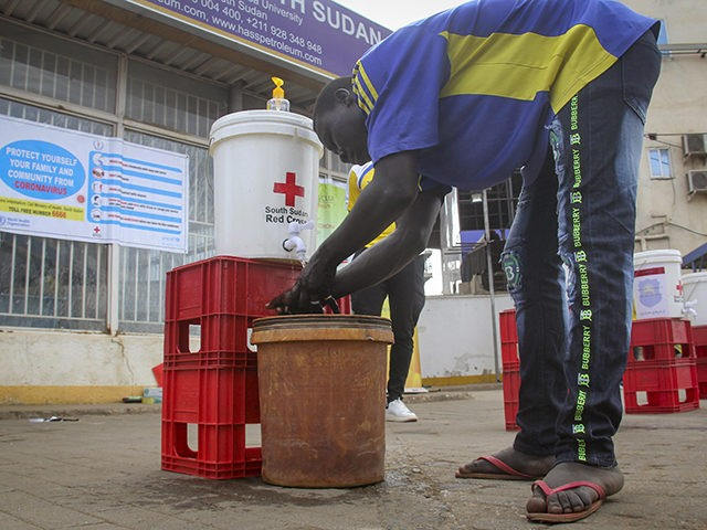 A man washes his hands to curb the spread of the new coronavirus in Juba, South Sudan, Monday, April 6, 2020. South Sudan on Sunday announced its first case of COVID-19, making it the 51st of Africa's 54 countries to report the disease. (AP Photo)