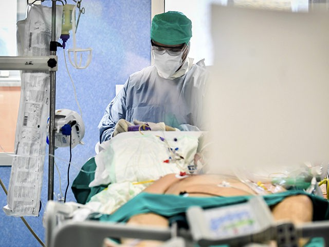 A doctor tends to patient in the Intensive Care Unit of the Bassini Hospital, in Cinisello Balsamo, near Milan, Italy, Tuesday, April 7, 2020. Domenico Arcuri, Italy's commissioner for fighting the COVID-19 virus, appealed to Italians ahead of the Easter weekend to not lower their guard and to abide by …