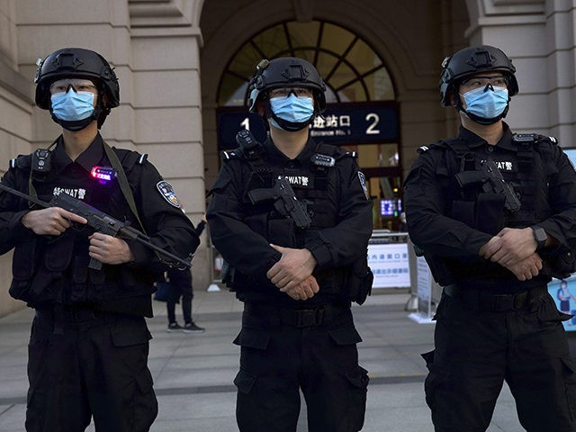 Police officers wearing face masks to protect against the spread of new coronavirus stand guard outside of Hankou train station ahead of the resumption of train services in Wuhan in central China's Hubei Province, Wednesday, April 8, 2020. After 11 weeks of lockdown, the first train departed Wednesday morning from …