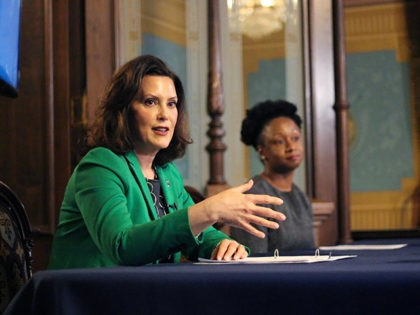 "In a pool photo provided by the Michigan Office of the Governor, Michigan Gov. Gretchen Whitmer addresses the state during a speech in Lansing, Mich., Thursday, April 9, 2020. The governor signed an executive order extending her prior ""Stay Home, Stay Safe"" order through the end of April. The order …"