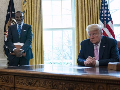 President Donald Trump prays during an Easter blessing event with Bishop Harry Jackson, in the Oval Office of the White House, Friday, April 10, 2020, in Washington. (AP Photo/Evan Vucci)
