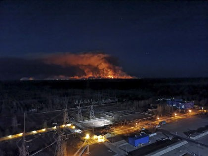 In this photo taken from the roof of Ukraine's Chernobyl nuclear power plant late Friday April 10, 2020, a forest fire is seen burning near the plant inside the exclusion zone. Ukrainian firefighters are labouring to put out two forest blazes in the area around the Chernobyl nuclear power station …