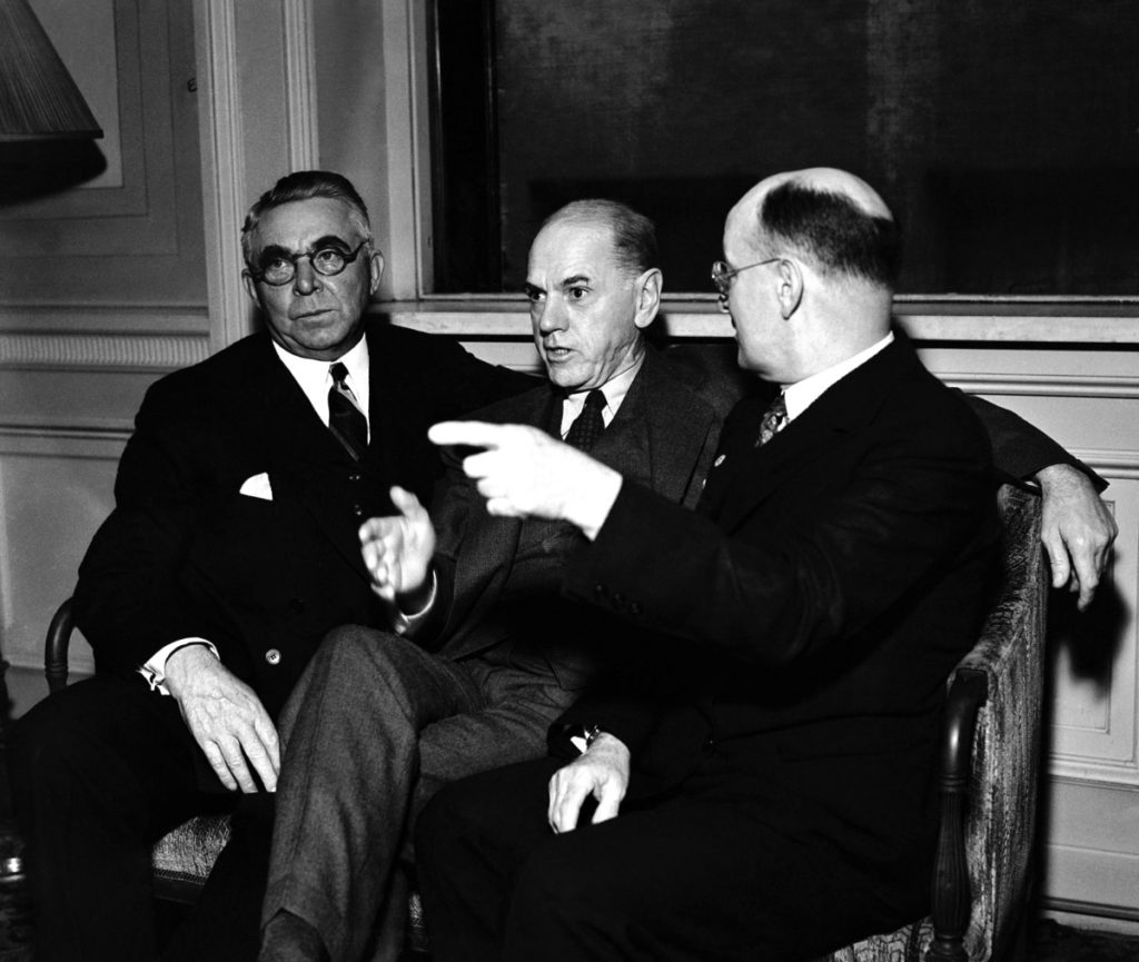 Tom Girdler (left), president of Republic Steel Corp., Eugene C. Grace (center), president of Bethlehem Steel Co., and W.A. Irvin, president of the United States Steel Corp., in Cleveland on Sept. 17, 1936 as they met in an informal conference before reviewing the industry's gains in radio addresses. (AP Photo)