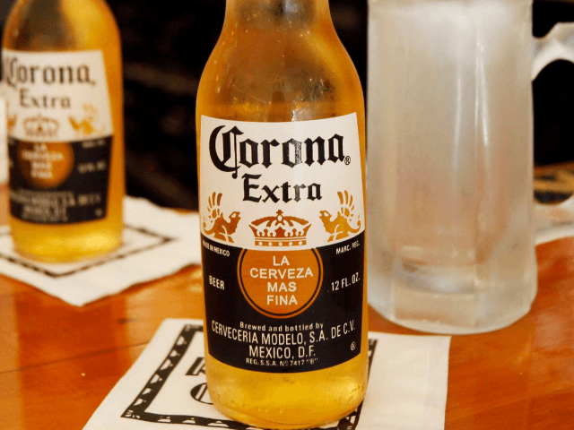 This Oct. 5, 2011 file photo, shows Corona Extra beers on a bar in Chagrin Falls, Ohio. (AP Photo/Amy Sancetta, File)AP