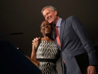 Bill de Blasio and wife, Chirlane McCray, hug at Gracie Mansion for the West Indian Heritage Reception.