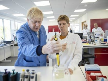 BEDFORD, ENGLAND - MARCH 06: Prime Minister Boris Johnson visits the Mologic Laboratory in the Bedford technology Park on March 06, 2020 in Bedford, England. The Prime Minister is announcing a £46 million funding package to help UK scientists develop testing kits and a vaccine in the fight against the …