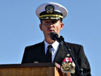 Capt. Brett Crozier addresses the crew for the first time as commanding officer of the aircraft carrier USS Theodore Roosevelt (CVN 71) during a change of command ceremony on the ship's flight deck. Crozier relieved Capt. Carlos Sardiello to become the 16th commanding officer of Theodore Roosevelt. (U.S. Navy photo …