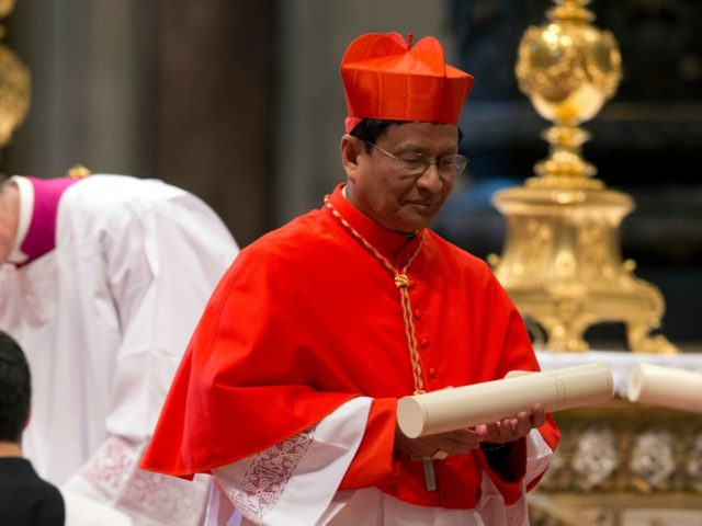 Newly-elected Cardinal Charles Maung Bo leaves after a consistory inside St. Peter's Basilica at the Vatican, Saturday, Feb. 14, 2015. Pope Francis welcomed 20 new cardinals Saturday into the elite club of churchmen who will elect his successor and immediately delivered a tough-love message to them, telling them to put …