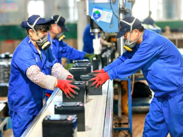 Employees working on a battery production line at a factory in an eastern Chinese province. (STR/AFP via Getty Images)