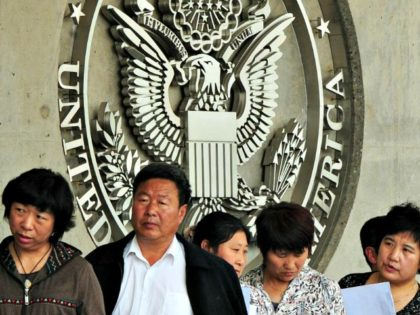 Chinese citizens wait to submit visa applications at the U.S. Embassy in Beijing. (MARK RALSTON/AFP/GettyImages)