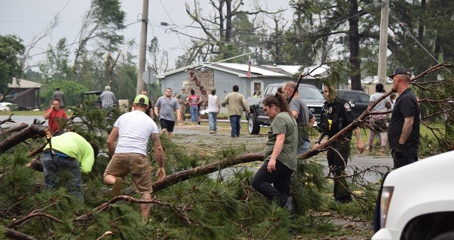 Community volunteers jumped into action to clear roadways from fallen trees to enable first responders access to people in need of rescue. (Photo: Lana Shadwick/Breitbart Texas)