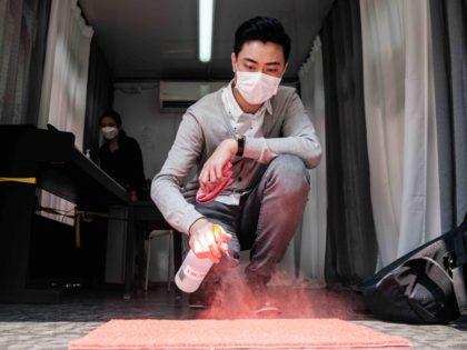 Coronavirus shoe mat (Anthony Wallace / AFP / Getty)