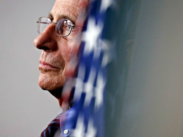 Dr. Anthony Fauci, director of the National Institute of Allergy and Infectious Diseases, listens during a briefing about the coronavirus in the James Brady Press Briefing Room of the White House, Thursday, April 9, 2020, in Washington. (AP Photo/Andrew Harnik)