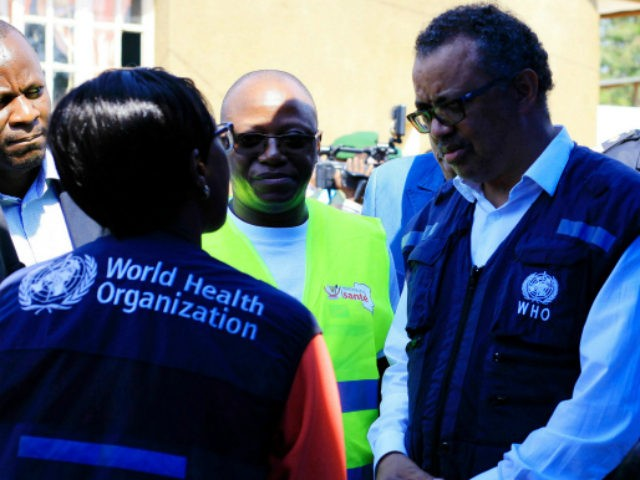 Dr. Tedros Adhanom Ghebreyesus, WHO Director General, centre, speaks to a health official at a newly established Ebola response center in Beni, Democratic Republic of Congo, Friday, Aug. 10, 2018. The World Health Organization's director-general says instability, high population density and large displacement in Congo's east mean the response to …