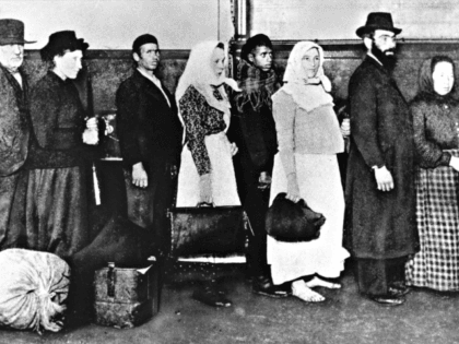 "FILE - In this undated photo of a group of immigrants, who arrived at Ellis Island in New York, wait in line to begin immigration proceedings. Senior White House aide Stephen Miller told reporters Wednesday, Aug. 2, 2017, that the poem written by Emma Lazarus about the ""huddled masses"" is …"