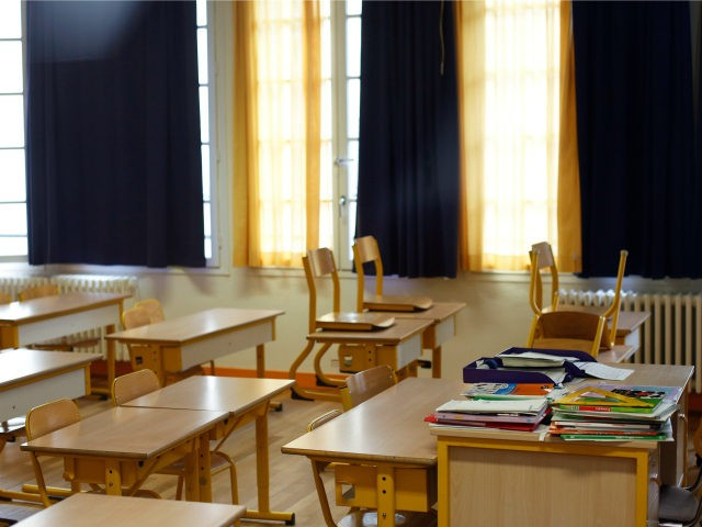 An empty classroom is seen at a closed school in Paris, Monday, March 16, 2020. France plans to close all creches, schools and universities from Monday until further notice to limit the spread of the novel coronavirus, President Emmanuel Macron says. For most people, the new coronavirus causes only mild …