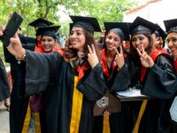 Students take selfie after receiving their Doctor of Philosophy (PhD) degree during the Golden Jubilee Year Convocation at the Guru Nanak Dev University (GNDU) in Amritsar on July 19, 2019. (Photo by NARINDER NANU / AFP) (Photo credit should read NARINDER NANU/AFP via Getty Images)