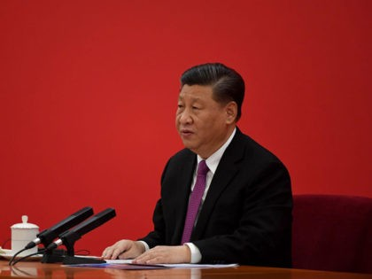 Chinas President Xi Jinping speaks to Russia's President Vladimir Putin via a video link, at the Great Hall of the People in Beijing on December 2, 2019. (Photo by Noel CELIS / POOL / AFP) (Photo by NOEL CELIS/POOL/AFP via Getty Images)