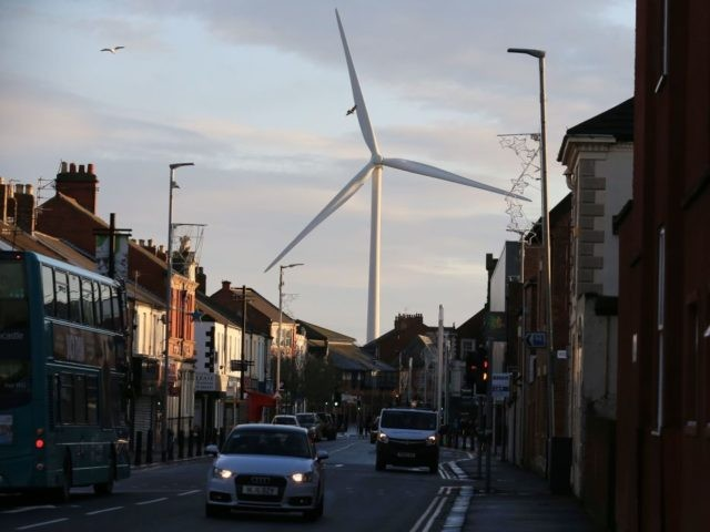 A general view shows a wind turbine over the town of Blyth in northeast England on December 13, 2019 the day after the former mining town voted in a Conservative MP for the first time in its history contributing to the Tory party's landslide victory. - UK Prime Minister and …