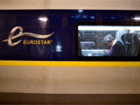 Passengers sit aboard the last Eurostar train before Brexit at Gare du Nord train station in Paris, on January 31, 2020. - Britain leaves the European Union at 2300 GMT on January 31, 2020, 43 months after the country voted in a June 2016 referendum to leave the block. The …