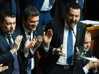 Italian Lega party far-right leader Matteo Salvini (R), supported by Lega member Gian Marco Centinaio (2ndL), reacts as he addresses the Senate on February 12, 2020 in Rome, as Italian senators are to decide whether he should face trial on charges of illegally detaining migrants at sea last year. - …