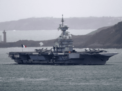 A picture taken on March 13, 2020, shows the French aircraft carrier Charles de Gaulle as it enters the port of Brest, in western France. - The aircraft carrier Charles de Gaulle arrives in Brest on March 13, 2020, as part of a mission in the Atlantic and the North …