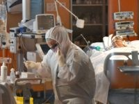 A medical worker wearing a protective gear works by a patient (Rear R) on March 24, 2020 at the new COVID 3 level intensive care unit for coronavirus COVID-19 cases at the Casal Palocco hospital near Rome, during the country's lockdown aimed at stopping the spread of the COVID-19 (new …