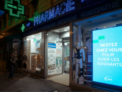 A woman waits for her turn outside a pharmacy at Place de Clichy, in Paris on April 9, 2020, on the twenty-fourth day of a lockdown in France to stop the spread of the novel coronavirus COVID-19. (Photo by JOEL SAGET / AFP) (Photo by JOEL SAGET/AFP via Getty Images)