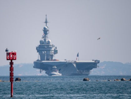 A picture shows the French aircraft carrier Charles de Gaulle on April 12, 2020, as it arrives in the southern French port of Toulon with sailors onboard infected with COVID-19 (novel coronavirus). - Fifty sailors aboard the Charles de Gaulle aircraft carrier, the flagship of the French navy, have contracted …