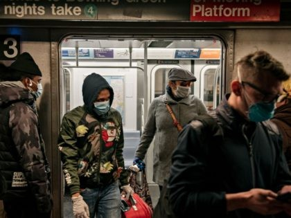 NEW YORK, NY - APRIL 17: Commuters wear face masks as they exit a subway train on April 17, 2020 in New York City. Following a new order from Governor Andrew Cuomo (D-NY) that New Yorkers must wear face coverings whenever social distancing is not possible, the measure is the …