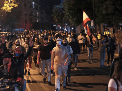 Lebanese demonstrators chant anti-government slogans while they walk through the streets of the capital Beirut on April 28, 2020, as anger over a spiralling economic crisis re-energised a months-old anti-government movement in defiance of a coronavirus lockdown. - Lebanese protesters confronted army troops for a second day as anger over …