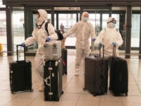 LONDON, UNITED KINGDOM - MARCH 17: Passengers determined to avoid the coronavirus before leaving the UK arrive at Gatwick Airport on March 17, 2020 in Gatwick, United Kingdom. Several UK and European carriers are reducing staff and practically grounding their fleets as governments worldwide impose travel restrictions to curb the …