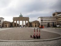 BERLIN, GERMANY - MARCH 19: Almost empty Pariser Platz by the Brandenburg Gate on March 19, 2020 in Berlin, Germany. Everyday life in Germany has become fundamentally altered as authorities tighten measures to stem the spread of the coronavirus. Public venues such as bars, clubs, museums, cinemas, schools, daycare centers …