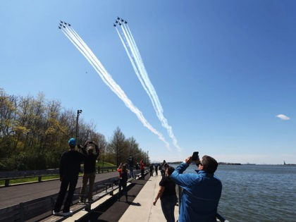 NEW YORK, - APRIL 28: The U.S. Navy's Blue Angels and U.S. Air Force's Thunderbirds perform a flyover across Brooklyn Bridge park as a tribute to honor NYC COVID-19 frontline workers on April 28, 2020 in the Brooklyn borough of New York City. The World Health Organization declared coronavirus (COVID-19) …