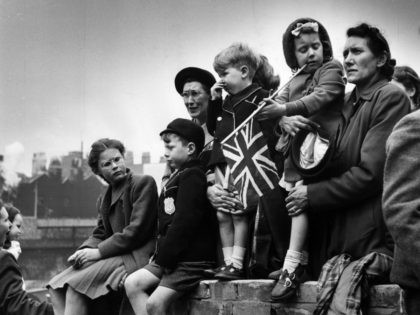 19th May 1951: Families watching the Royal procession as King George VI goes to St Paul's to declare the Festival of Britain open. Original Publication: Picture Post - 5306 - The Royal Opening To Britain's Festival - pub. 1951 (Photo by Picture Post/Hulton Archive/Getty Images)