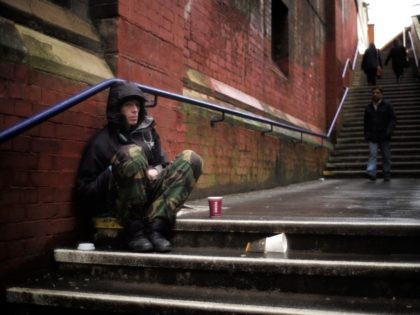 MANCHESTER, UNITED KINGDOM - FEBRUARY 25: A man begs for loose change on the streets of Manchester on February 25, 2015 in Manchester, United Kingdom. As the United Kingdom prepares to vote in the May 7th general election many people are debating some of the many key issues that they …