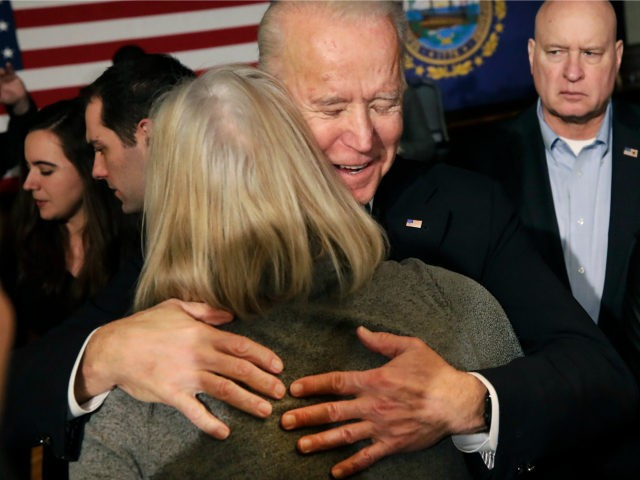 Democratic presidential candidate former Vice President Joe Biden hugs a woman at a campaign event, Wednesday, Feb. 5, 2020, in Somersworth, N.H. (AP Photo/Elise Amendola)