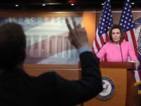 Journalist and Nancy Pelosi (Chip Somodevilla / Getty)