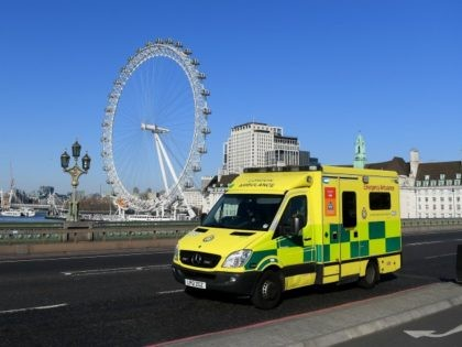 LONDON, ENGLAND - MARCH 25: An Ambulance crosses Westminster Bridge on March 25, 2020 in London, England. British Prime Minister, Boris Johnson, announced strict lockdown measures urging people to stay at home and only leave the house for basic food shopping, exercise once a day and essential travel to and …