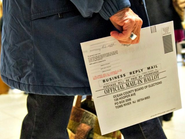 An Ocean County voter in Toms River, New Jersey, carries her completed ballot in an envelope on Nov. 5, 2012. (Paul J. Richards/AFP/Getty Images)