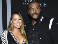 "Singer Mariah Carey, left, and filmmaker Tyler Perry pose together at the premiere of Tyler Perry's ""A Fall from Grace"" at Metrograph on Monday, Jan. 13, 2020, in New York. (Photo by Evan Agostini/Invision/AP)"