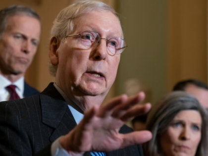 Senate Majority Leader Mitch McConnell, R-Ky., joined by Majority Whip John Thune, R-S.D., left, and Sen. Joni Ernst, R-Iowa, tells reporters he has secured enough Republican votes to start President Donald Trump's impeachment trial and postpone a decision on witnesses and documents Democrats want, at the Capitol in Washington, Tuesday …