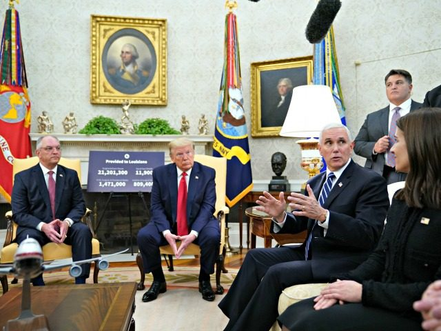 US Vice President Mike Pence speaks during a meeting with US President Donald Trump, Louisiana Governor John Bel Edwards (L) and Dr. Blythe Adamson (R seated), senior quantitative scientist at Flatiron Health, in the Oval Office of the White House in Washington, DC on April 29, 2020. (Photo by MANDEL …