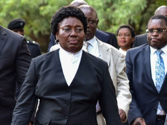 Uganda's President Yoweri Museveni (C) walks with First Lady Janet Museveni (R) and Speaker of Parliament Rebecca Kadaga (L) after delivering the state of the nation address in front of Members of Parliament and diplomats in Kampala, Uganda, on June 6, 2018. (Photo by Nicholas Bamulanzeki / AFP) (Photo credit …