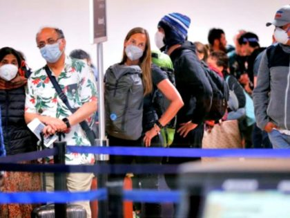Travellers await for their flights out of Peru on March 16, 2020 at the Jorge Chavez international airport in Callao, Lima, minutes before borders are closed. - On March 15, 2020, President Martin Vizcarra announced a State of Emergency and a two-week nationwide home-stay curfew together with the closure of …