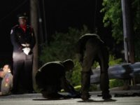 A San Marcos Police honor guard member stands guard as officers investigate the shooting death of one of their officers. (AP Photo: Eric Gay)