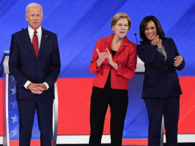 Debate stage--Joe Biden, Elizabeth Warren clapping, and Kamala Harris pointing