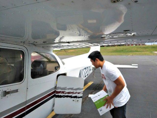 TJ Kim loads medical supplies into a plane, Leesburg, Virginia.Thomas Kim via AP