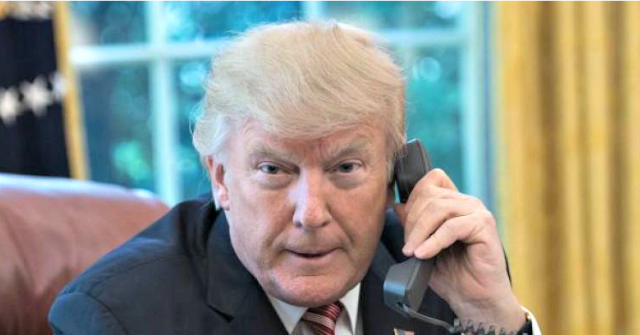 Trump on telephone facing camera 640x335
