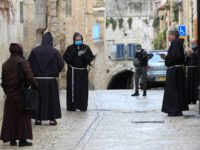 Fransiscan friars, some wearing protective gear amid the COVID-19 outbreak, pray at the first station while taking part in a small Procession of the Way of the Cross along the Via Dolorosa to mark Good Friday in Jerusalem, on April 10, 2020. - All cultural sites in the Holy Land …